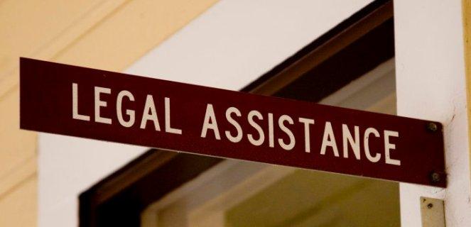 2014-11-19-LegalAssistance_Sign
